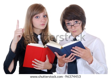 two young women with books looking strictly