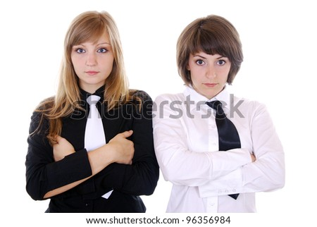 two young women with crossed arms