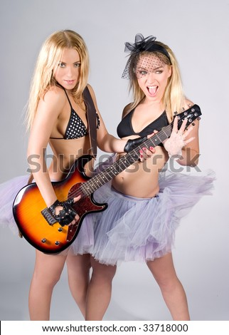 Two young women with guitar