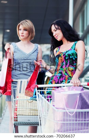 Two young women with shopping carts