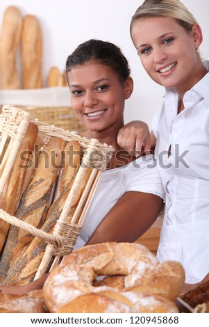 Two young women working in a bakery - stock photo