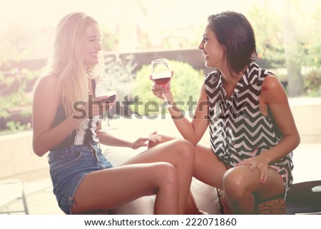 two youngs women with cups - stock photo