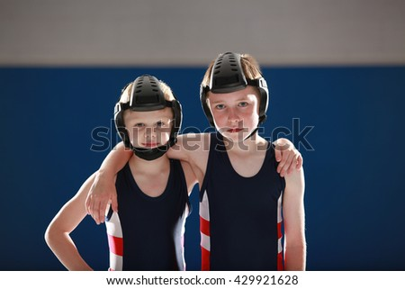 Two youth wrestlers after a good workout - stock photo