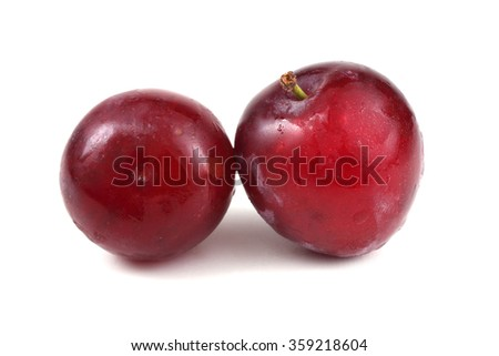 Twp red plums