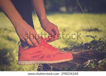 Tying running shoes.