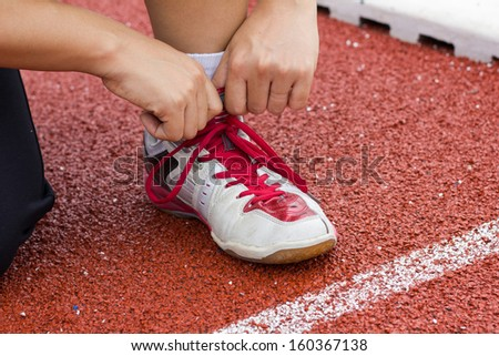 Tying sports shoe  - stock photo