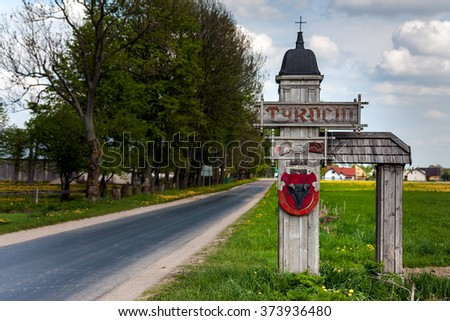 TYKOCIN, POLAND - MAY 10, 2010: Tykocin welcome sign. Road sign with bull head coat of arms - stock photo