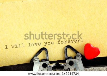 Typed love letter printed in words for Valentine's Day written on vintage typewriter - stock photo