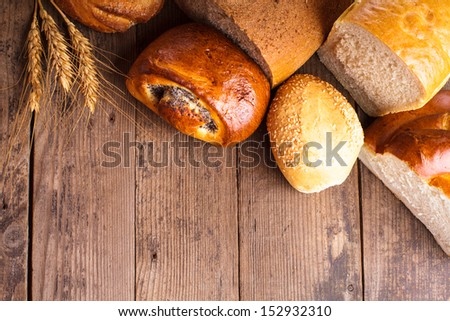 Types of homemade bread on the rustic wooden table - stock photo
