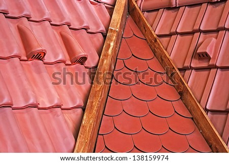 Types of roof tiles with various ventilation and fastening elements. - stock photo
