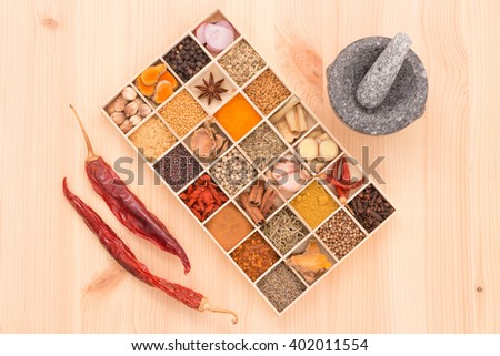 Types of spicy herbs with aromatic spices Was inserted in wood are cut into pieces and grind a little and mortar put on Wooden. - stock photo