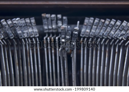 Typewriter an electric, electronic, or manual machine with keys for producing print like characters one at a time on paper inserted around a roller. - stock photo