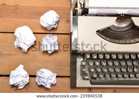 Typewriter and balls of paper - stock photo