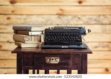 typewriter and books on the table, vintage typewriter and old books, vintage,writer Area, typewriter, old typewriter with blank paper on wooden desk, old typewriter keys, antique, retro
