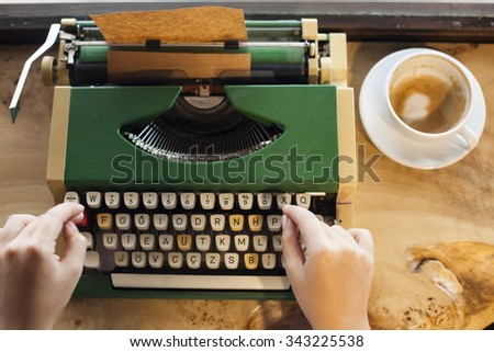 typewriter, hand and coffee - stock photo