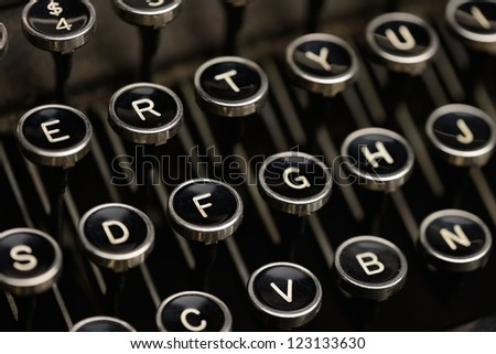 Typewriter keys. Angled shot of keys on an antique typewriter. Shallow DOF. - stock photo