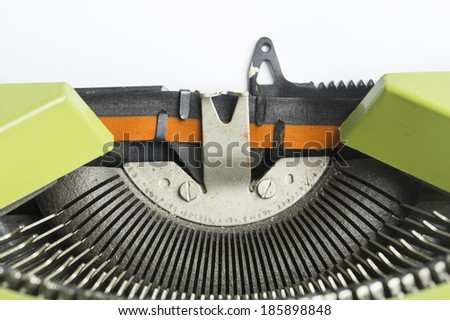 Typewriter macro with empty paper - stock photo