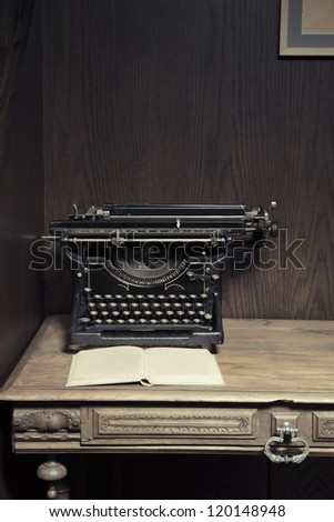 typewriter on desk with book