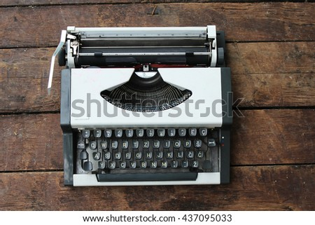 Typewriter on old wooden background