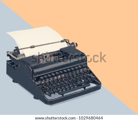 Typewriter over a pastel background