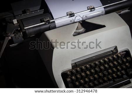 Typewriter Thai in the dark room - stock photo