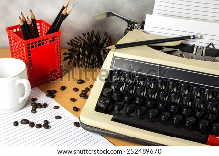 Typewriter with a coffee on work desk - stock photo
