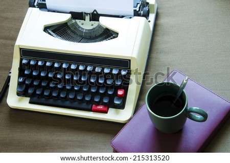 Typewriter with a fabric background. - stock photo