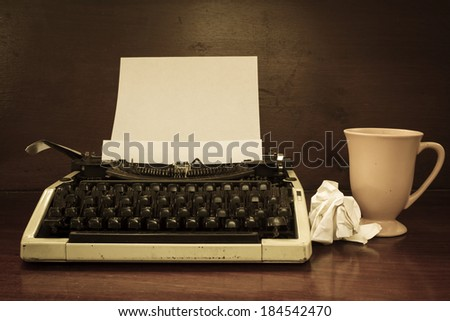 Typewriter with coffee cup,sepia color style. - stock photo