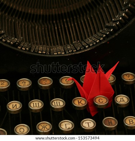 typewriter with origami crane - stock photo