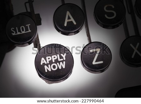 Typewriter with special buttons, apply now - stock photo