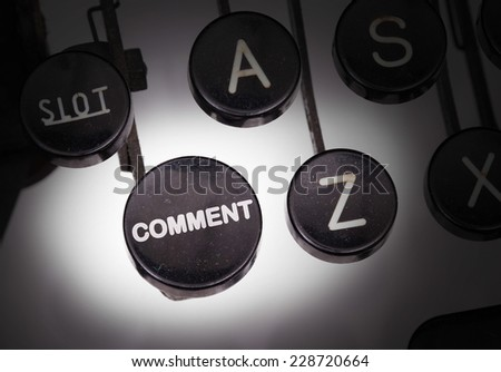 Typewriter with special buttons, comment - stock photo