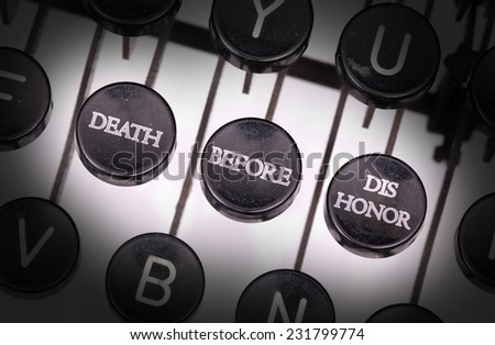 Typewriter with special buttons, death before dishonor - stock photo