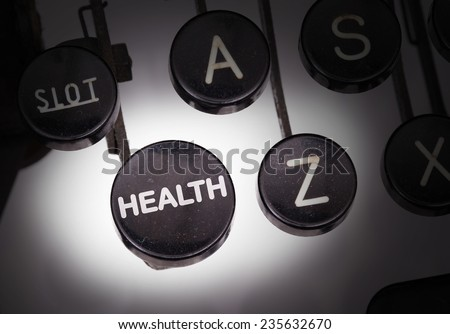 Typewriter with special buttons, health - stock photo