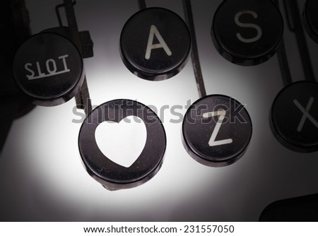 Typewriter with special buttons, heart - stock photo