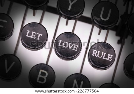 Typewriter with special buttons, let love rule - stock photo