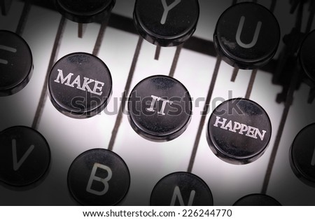 Typewriter with special buttons, make it happen - stock photo