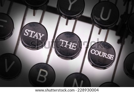 Typewriter with special buttons, stay the course - stock photo