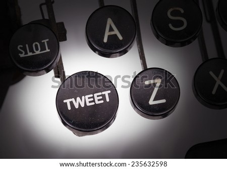 Typewriter with special buttons, tweet - stock photo