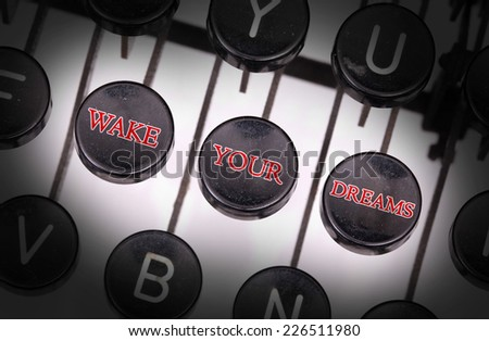 Typewriter with special buttons, wake your dreams - stock photo
