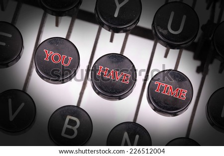 Typewriter with special buttons, you have time - stock photo