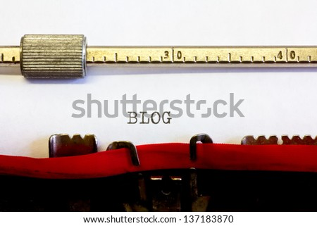 typewriter with the following text: blog - stock photo