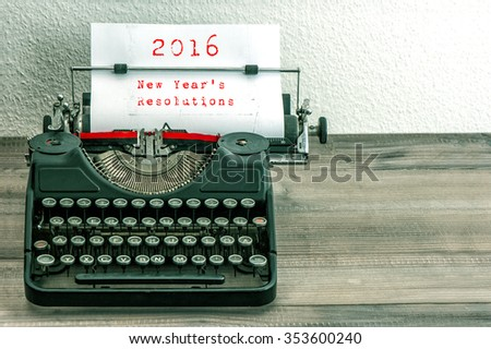 Typewriter with white paper page on wooden table. sample text 2016 New Year's Resolutions. Vintage style toned picture - stock photo