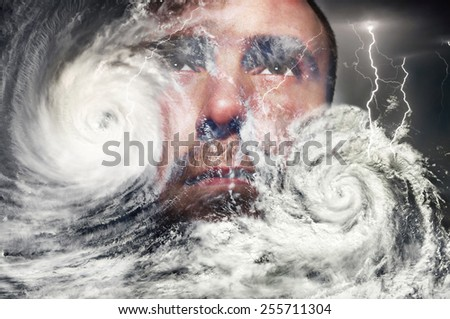 Typhoon, storm and a human face - stock photo