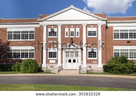 Typical American brick school building on sunny day - stock photo