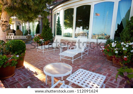 Typical American patio with outdoor furniture - stock photo