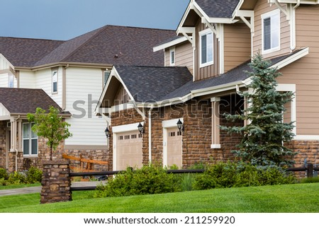 Typical American suburban community with model homes. - stock photo