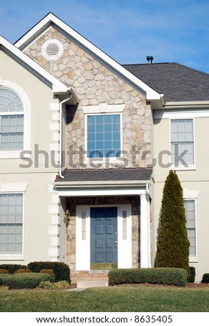 typical american suburban single family house with blue door - stock photo