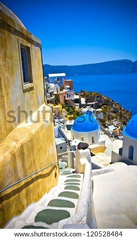 Typical and amazing colorful street in Oia city, Santorini, Greece - stock photo