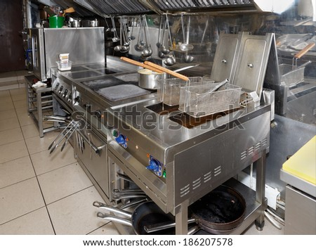Typical and not too clean restaurant kitchen  - stock photo
