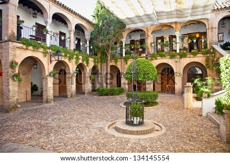 Typical andalusian mudejar courtyard In Seville, Spain. - stock photo